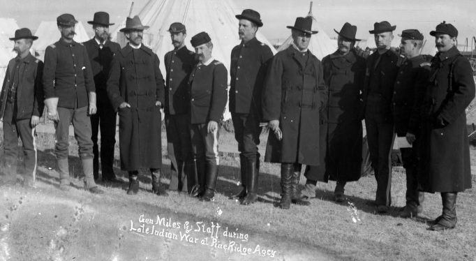 Major General Miles and his staff at Pine Ridge, January 1891. From left to right are Captain Ezra P. Ewers, Lieutenant John S. Mallory, Captain Francis E. Pierce, Lieutenant Colonel Dallas Bache, Captain Francis J. Ives, Major Jacob Ford Kent, Lieutenant Colonel Henry C. Corbin, Major General Nelson A. Miles, Captain Frank D. Baldwin, Lieutenant Sydney A. Cloman, Captain Charles F. Humphrey, and Captain Marion P. Maus.