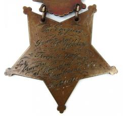Inscription on the reverse side of Private Hobday's Medal of Honor. The Congress to Private George Hobday, Troop A, 7th Cav'y for bravery at Wounded Knee Creek, S. D. Dec. 29 1890.