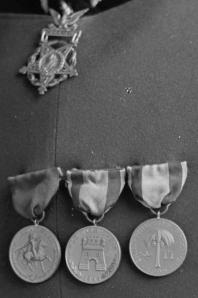 Close up of Brig. Gen. E. A. Garlinton's Medal of Honor, and campaign medals from the Indian Wars, Spanish War and Philippine Insurrection.