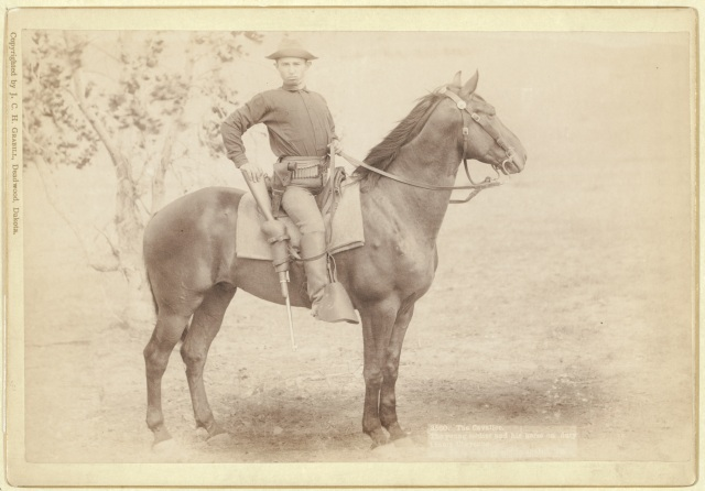 """The Cavalier. The young soldier and his horse on duty at camp Cheyenne,"" by J. C. H. Grabill, 1890, Deadwood, Dakota."