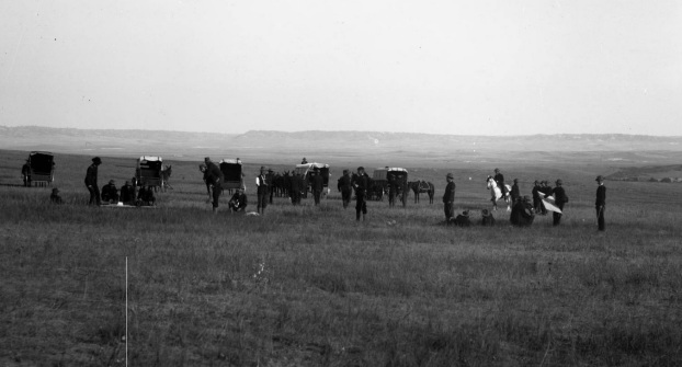 "This 1890 photograph titled, ""Pine Ridge Agency, S.D. (field maneuvers)"" depicts soldiers of the hospital corps at the Pine Ridge Agency practicing their craft. (From the Louise Stegner collection held in the Denver Public Library Digital Collections)"