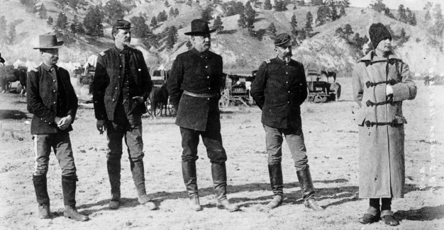 Brigadier General John R. Brooke and staff at Pine Ridge, published January 1891 by A. G. Johnson, York, Ne-braska. Left to right 1st Lt. C. M. Truitt, 21st Infantry, Aide-de-camp; Maj. D. W. Benham, 7th Infantry, Inspector of rifle practice; Gen. Brooke, Commander, Department of the Platte; Maj. J. M. Bacon, 7th Cavalry, Inspector General; 1st Lt. F. W. Roe, 3rd Infantry, Aide-de-camp. Photograph is from the Denver Public Library Western History Collection, Call number x-31491.